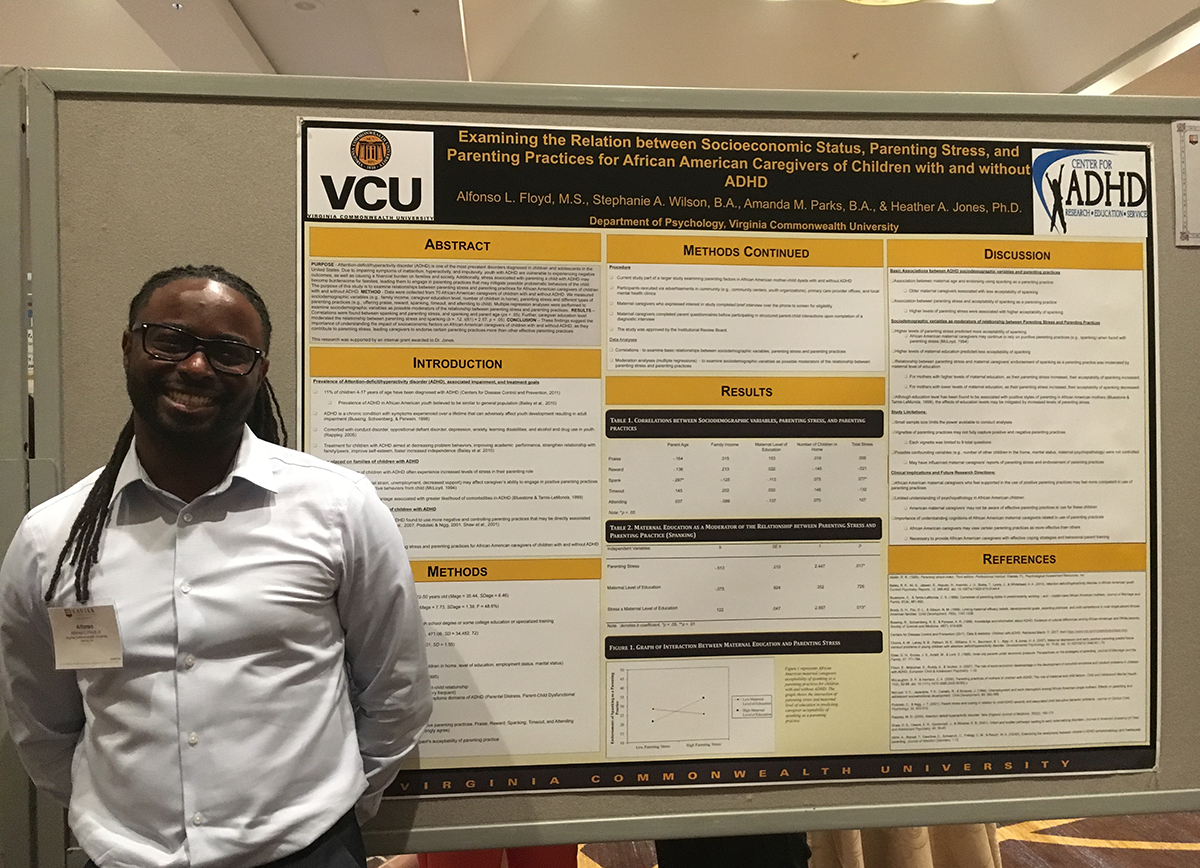 Alfonso Floyd at the 2017 XULA Diversity Conference in front of a research poster titled