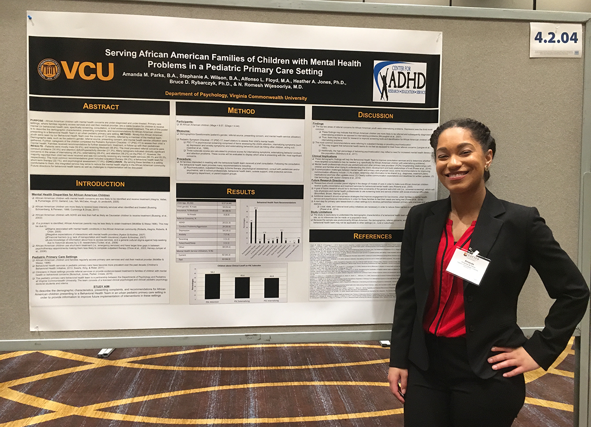 Amanda Parks at the 2017 XULA Diversity Conference standing in front of her research poster, which is titled